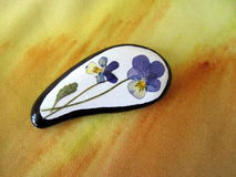 White stone with pansy flower Stock Image