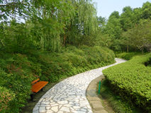 White stone path with bench Royalty Free Stock Photos
