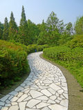 White stone path under blue sky Stock Photos