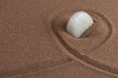 White stone in sand. White stone in brown sand Royalty Free Stock Photo