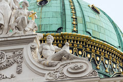White stone sculpture group on the background of the dome in Vie Royalty Free Stock Photo