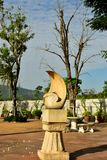 The White Stone Sculture in the garden with Dried Tree royalty free stock photos