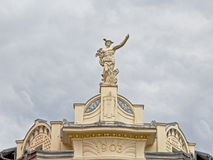Statue of the Greek god Hermes on top of a renaissance revival building in Ljubljana, Slovenia royalty free stock photo