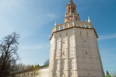 White stone tower. On the background of blue sky Royalty Free Stock Photography