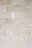 White stone wall for background design. Stock Image