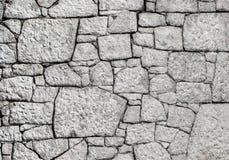 White Stone Wall. Crazed white stone wall background Royalty Free Stock Image