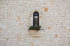 White Stone Wall with Flower Box in Window Stock Photography