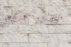 White stone wall in perspective with texture and bricks detail. Abstract background wall with white textured bricks, similar to marble. Setoff with shadows stock photography
