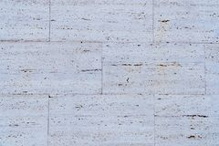 White stone wall texture on street stock image
