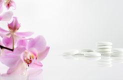 White stones. And pink orchid, spa Royalty Free Stock Photography