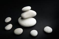 White stones against black Stock Image