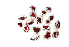 White stones decorated with red hearts and love symbols isolated on white background. stock images