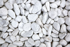 White stones at a grave as a background Stock Photo