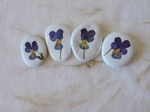 White stones with pansy flowers Royalty Free Stock Photography
