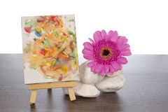 White stones pink gerbera and easel Stock Image