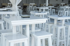 White stools and tables. In the beach bar Royalty Free Stock Images