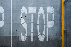 White stop traffic sign over asphalt lane. Stock Photos