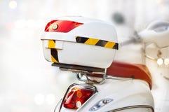 White storage box on back of motorcycle on street Stock Image