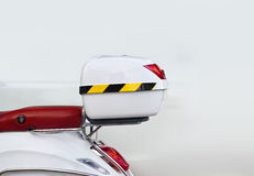 White storage box on back of motorcycle on street Royalty Free Stock Images
