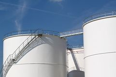White storage tanks. Storage tanks at an oil refinery Royalty Free Stock Images