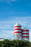 White storage tanks with red stripes Stock Photo