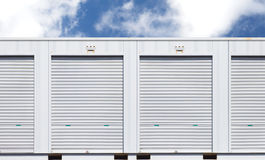 White storage unit or small warehouse for rental. Exterior of white storage unit or small warehouse for rental Royalty Free Stock Image