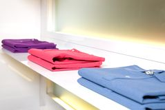 White store shelf with color clothes Stock Photography