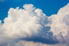 White stormy clouds. White stormy fluffy clouds on blue sky Royalty Free Stock Images