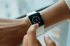 White Strap and Black Apple Watch Royalty Free Stock Photo