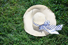 White straw hat. With black and white ribbon Stock Image