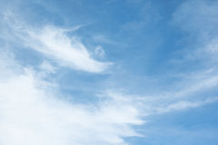 White streaks of clouds on a bright blue sky, sunny summer day,. Horizontal image Stock Image