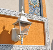 White street lamp on colorful wall Stock Images
