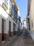 White street sloped of Carmona. White street sloped decorated with white houses and bars in their windows It is Situated in a village in Spain Called Carmona Stock Photo