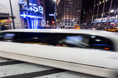 Stretched Limo. A white stretched limousine making its way through the streets of Manhatten, New York Royalty Free Stock Photography