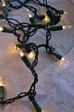 White string lights against white background Stock Photos