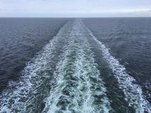White strip after cruise ship on open sea Stock Images