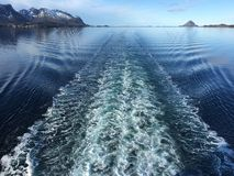 A long wake of a cruise ship in beautiful nature in Nordland, Norway. Stock Images