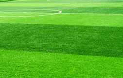 White stripe on artificial green grass of soccer field Royalty Free Stock Image
