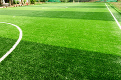 White stripe on artificial green grass of soccer field Stock Images