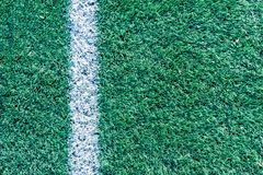 White stripe on the artificial green soccer field. Top view Royalty Free Stock Photo