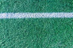 White stripe on the artificial green soccer field. Top view Stock Photo