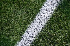 White stripe on a bright green artificial grass soccer field.  stock images