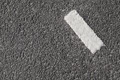 White stripe on dark gray asphalt Stock Photography