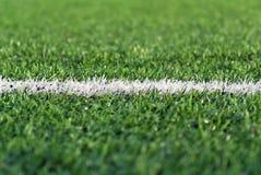 The white stripe on the football field. A white stripe on the artificial surface football field Royalty Free Stock Photo