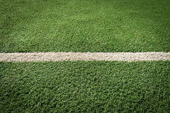 White stripe on the green grass Stock Photos