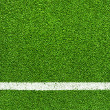White stripe on the green soccer field. From top view Royalty Free Stock Image