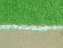 White stripe on the green soccer field from Royalty Free Stock Photo