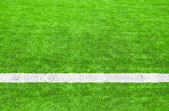 White stripe on the green soccer field. Royalty Free Stock Photos