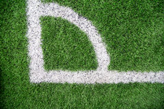 White stripe on the green soccer field. stock images