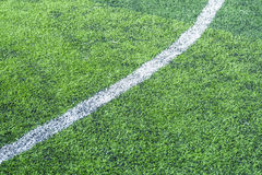 White stripe on the green soccer field Stock Images